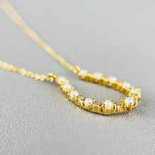 Load image into Gallery viewer, Pearl and diamond horseshoe necklace in 14k yellow gold