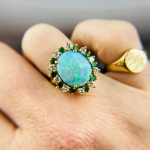 14k yellow gold large opal, diamond, and emerald halo ring