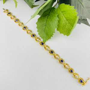 Sapphire and diamond bracelet in 18k yellow gold