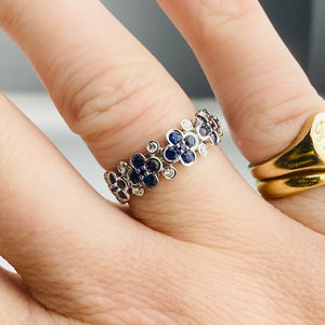 Sapphire and diamond floral bubble band in white gold