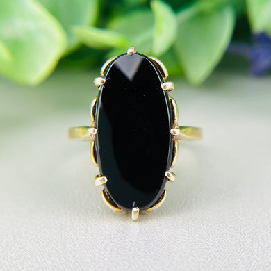 Vintage yellow gold oval onyx ring