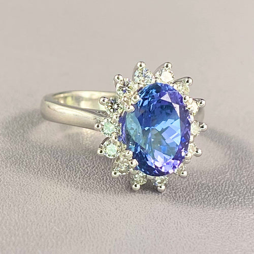 Tanzanite and diamond cluster halo ring in white gold