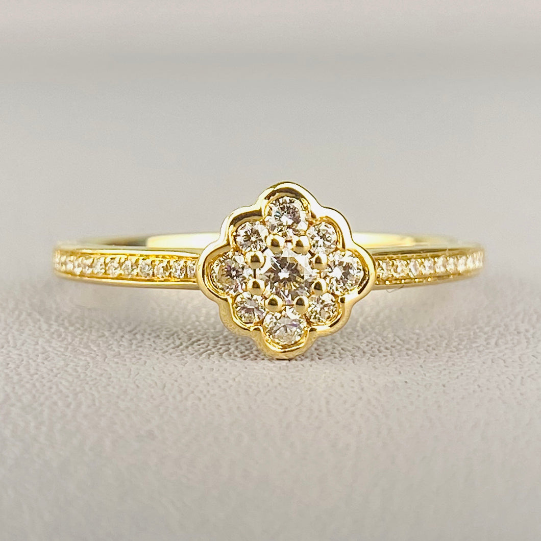 Dainty diamond cluster ring in yellow gold