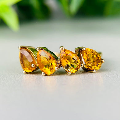 Citrine pear shaped 4 stone ring in 14k yellow gold