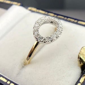 Diamond halo ring in yellow gold