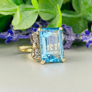 Blue topaz and diamond ring in 14k yellow gold