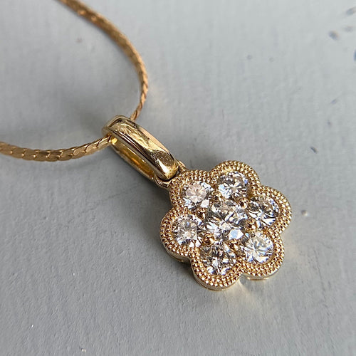 Diamond cluster pendant in 14k yellow gold