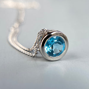 Blue topaz necklace in 14k white gold