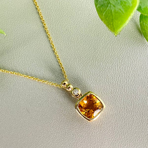 Citrine and diamond necklace in 14k yellow gold