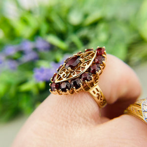 Vintage garnet navette ring in yellow gold