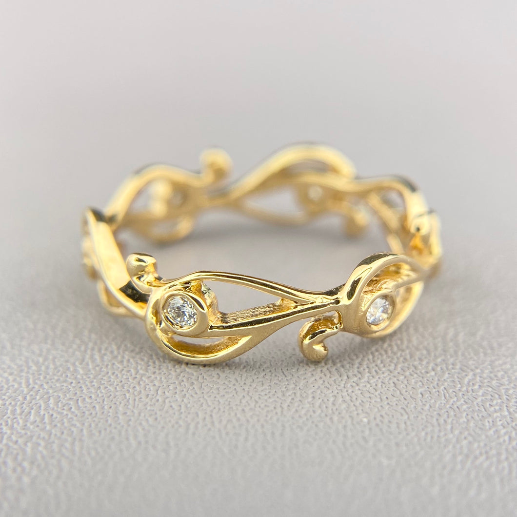 Diamond scroll band in yellow gold