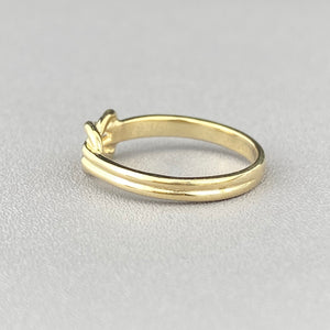 Yellow gold lovers knot ring