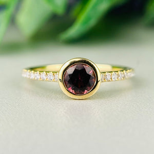 Rubellite and diamond ring in 14k yellow gold