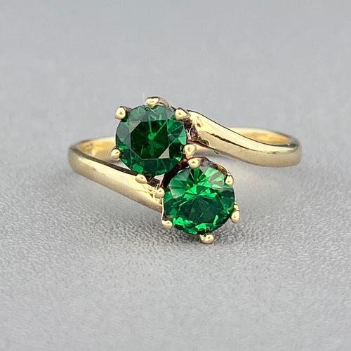 Green spinel triplet bypass ring in yellow gold