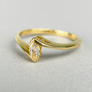 Diamond marquise solitaire ring in 14k yellow gold