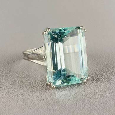 Large aquamarine emerald cut ring in 18k white gold