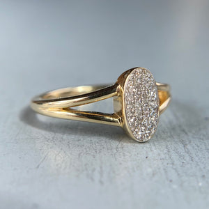 Diamond oval cluster ring in yellow gold