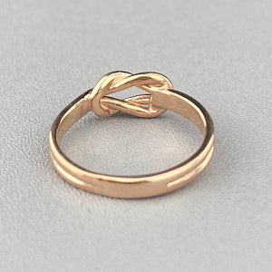 Rose gold lovers knot ring