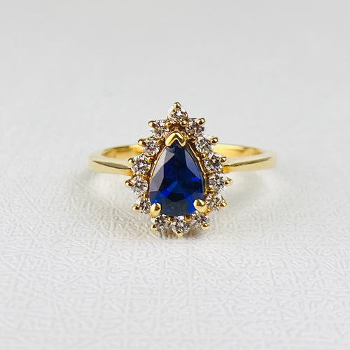 Sapphire and diamond cluster ring in 18k yellow gold