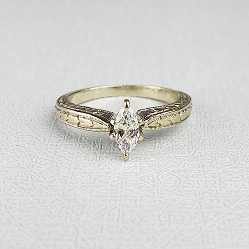 Diamond marquise solitaire ring in 14k white gold
