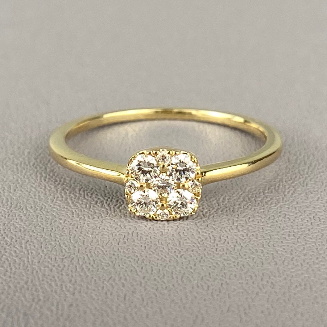 Delicate diamond cluster ring in yellow gold