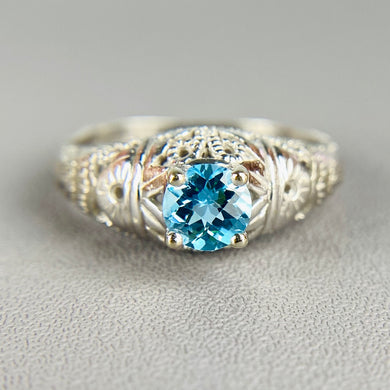Blue topaz ring in white gold