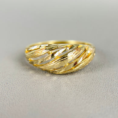 Yellow gold dome ring with diamond cut design