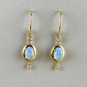 Opal and diamond earrings in 14k yellow gold