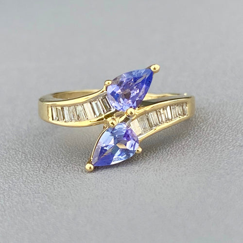 Iolite and diamond bypass ring in yellow gold