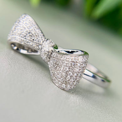 Diamond studded bow ring in 14k white gold