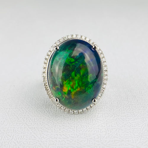Magnificent Opal and diamond ring in platinum