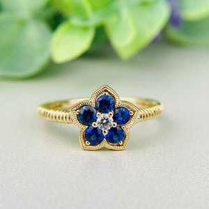 Sapphire and diamond ring in 14k yellow gold