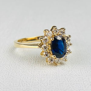 Sapphire and diamond cluster ring in 14k yellow gold