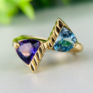 Blue topaz and amethyst bypass ring in 10k yellow gold