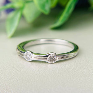 3 stone diamond band in white gold