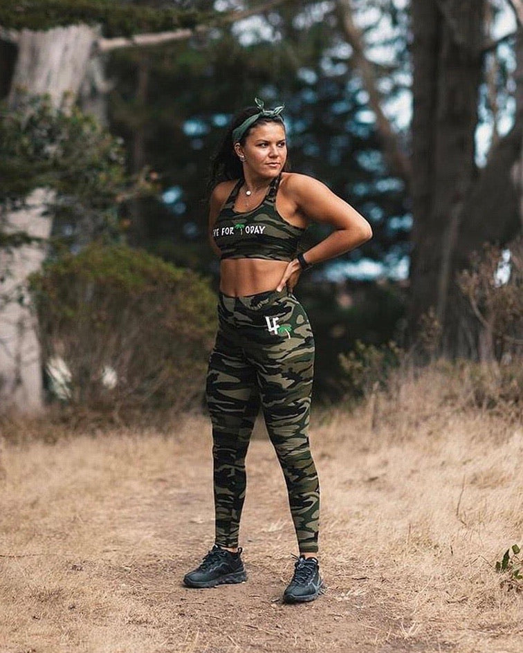 woman in camo leggings