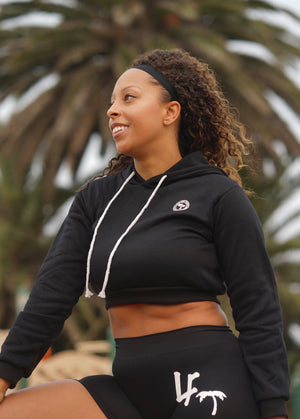 woman in cropped hoodie