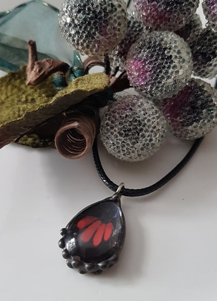 Black Butterfly with Red Stripes Teardrop Pendant