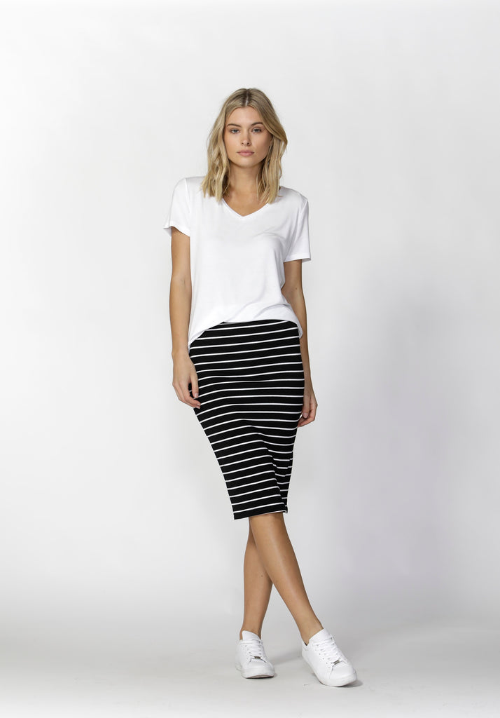 Woman wearing black and white stripe Betty Basics Alicia Midi Skirt from My Sister Elle clothing