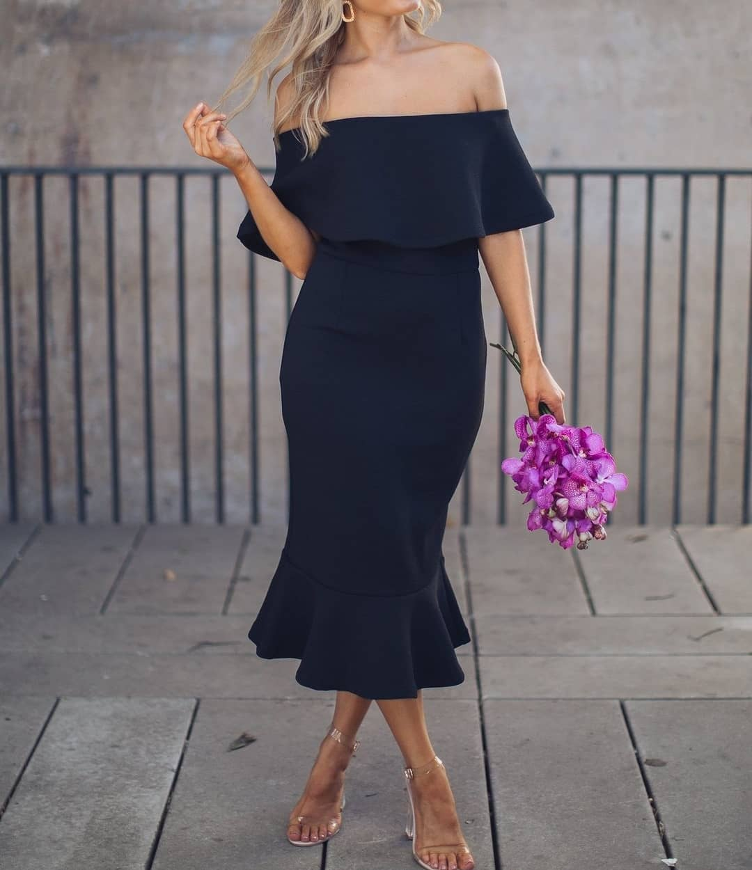 Woman wearing black Ebby & I Off the Shoulder Dress from My Sister Elle clothing