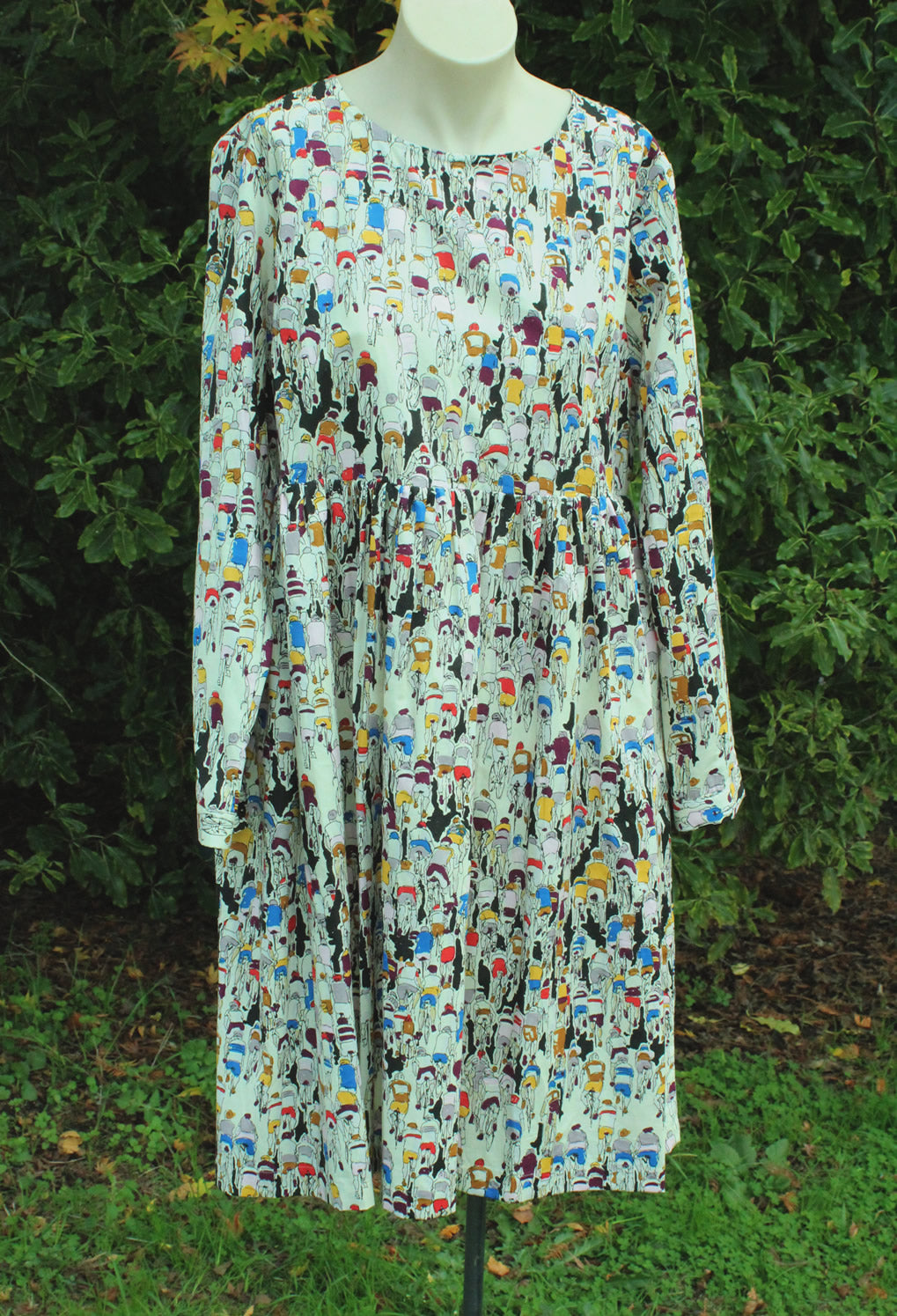 Dress on Manequin. Long Sleeves all over cycle print.