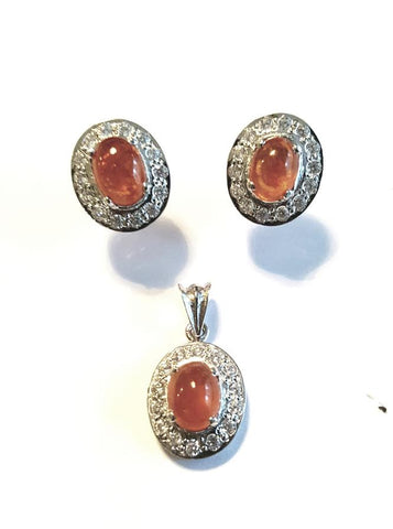 A beautiful pendant and earrings set by Amna's Inspiration set with Amber and Cubic Zirconia.