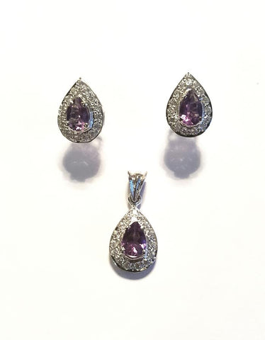 A beautiful pendant and earrings set by Amna's Inspiration set with Amethyst and Cubic Zirconia.