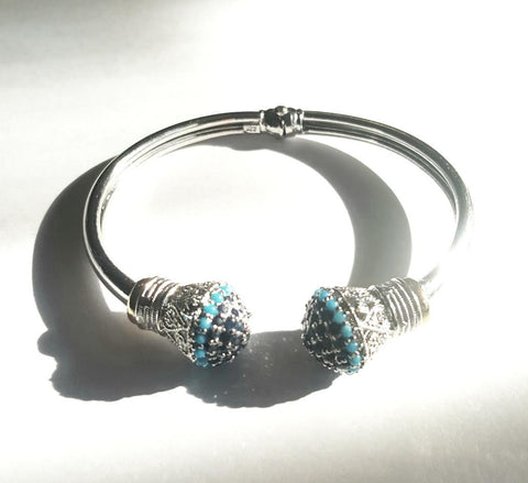sterling silver bracelet by Amna's Inspiration set with sapphires and turquoise