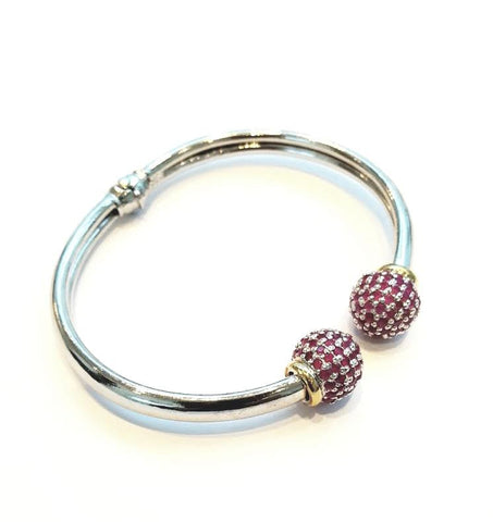 A beautiful bracelet by Amna's Inspiration in Rhodium plated sterling silver, set with rubies.
