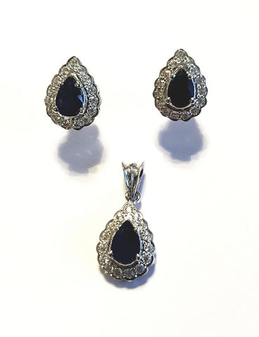 A beautiful pendant and earrings set by Amna's Inspiration set with Sapphires and Cubic Zirconia.