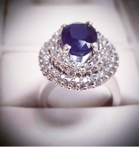 Sterling silver ring by Amna's Inspiration with genuine sapphire and cubic zirconia.