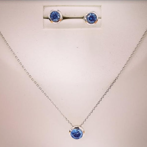 sterling silver pendant and earrings by Amna's Inspiration with blue Swarovski Cubic Zirconia.