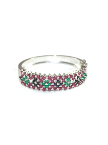 A beautiful bracelet by Amna's Inspiration in Sterling Silver studded with rubies, emeralds and sapphires