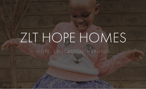 image of young girl from ZLT Hope Home dancing, wearing pink sweater with a cartoon animal's face on the front, overlayed with the words ZLT Hope Homes